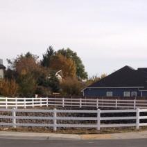 Three rail white vinyl fencing